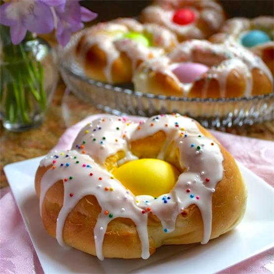 A light brioche dough is formed around colored eggs and iced!