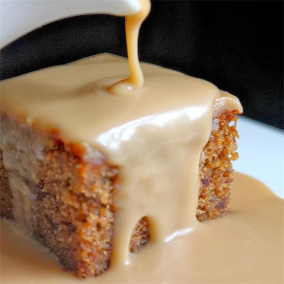 Sticky Toffee Sauce is poured over a lovely date cake!