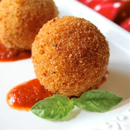 Sicilian deep fried rice balls, filled with cheese and sauce!