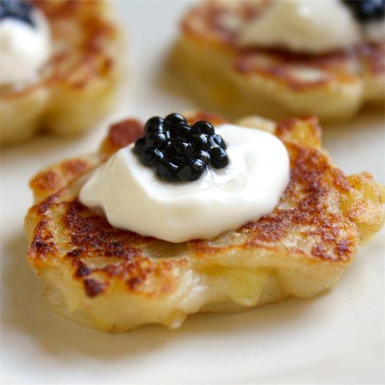 Mini Irish Boxty pancakes topped with creme fraiche and caviar