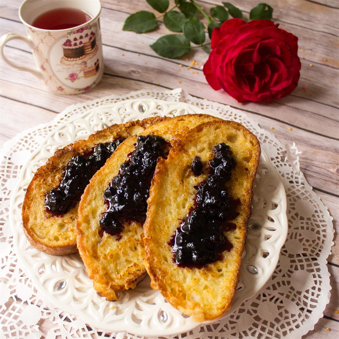 Sweet eggy breakfast bread slices with blueberry jam
