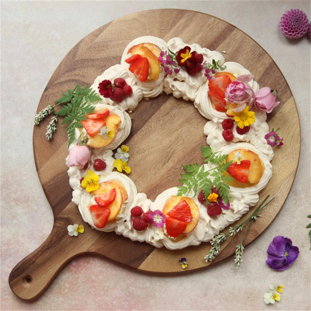 Simple meringue wreath with lemon curd and edible flowers