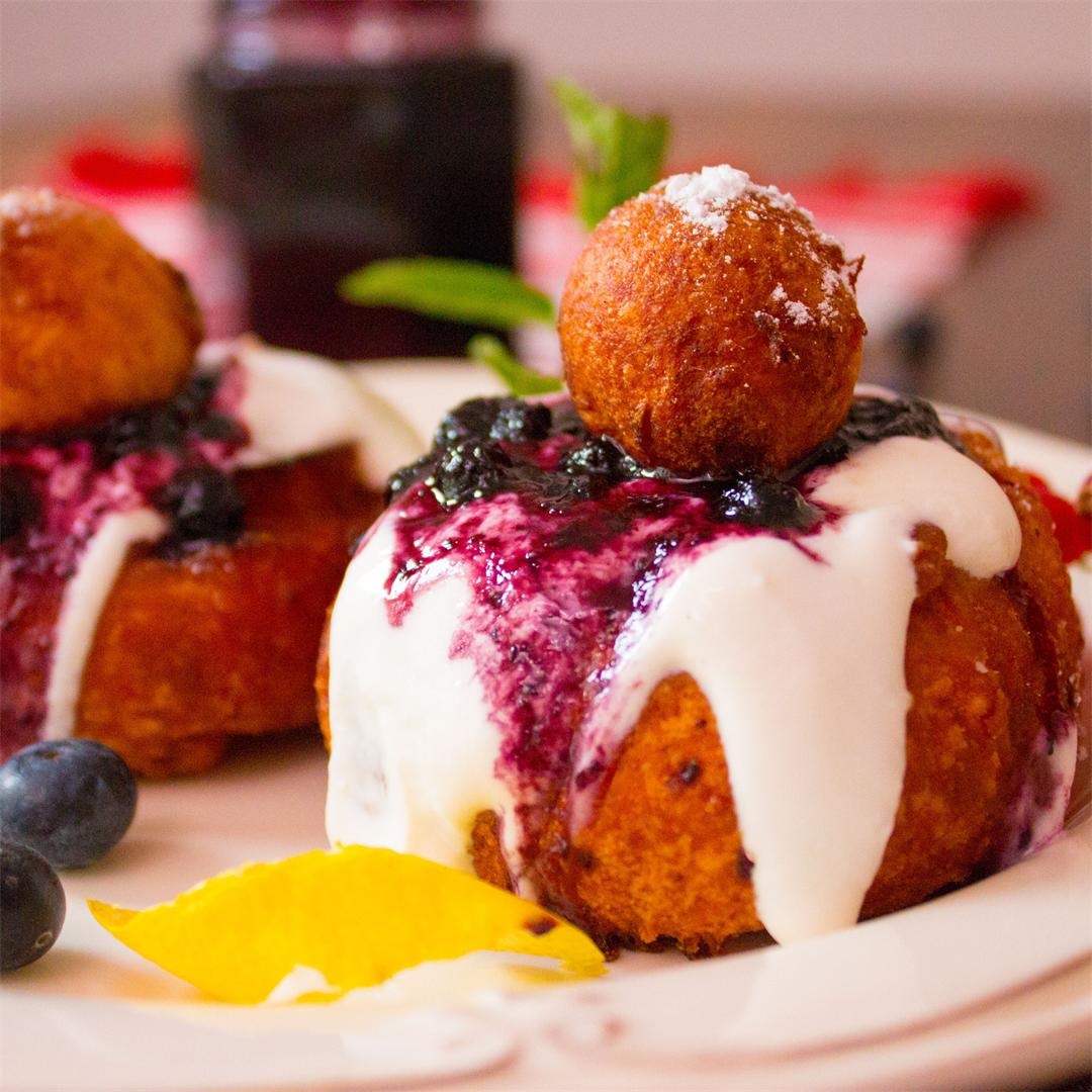 Cottage cheese doughnuts with sour cream and blueberry preserve