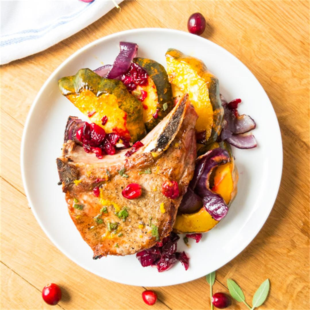 Acorn squash & pork chop with cranberries sheet pan dinner.