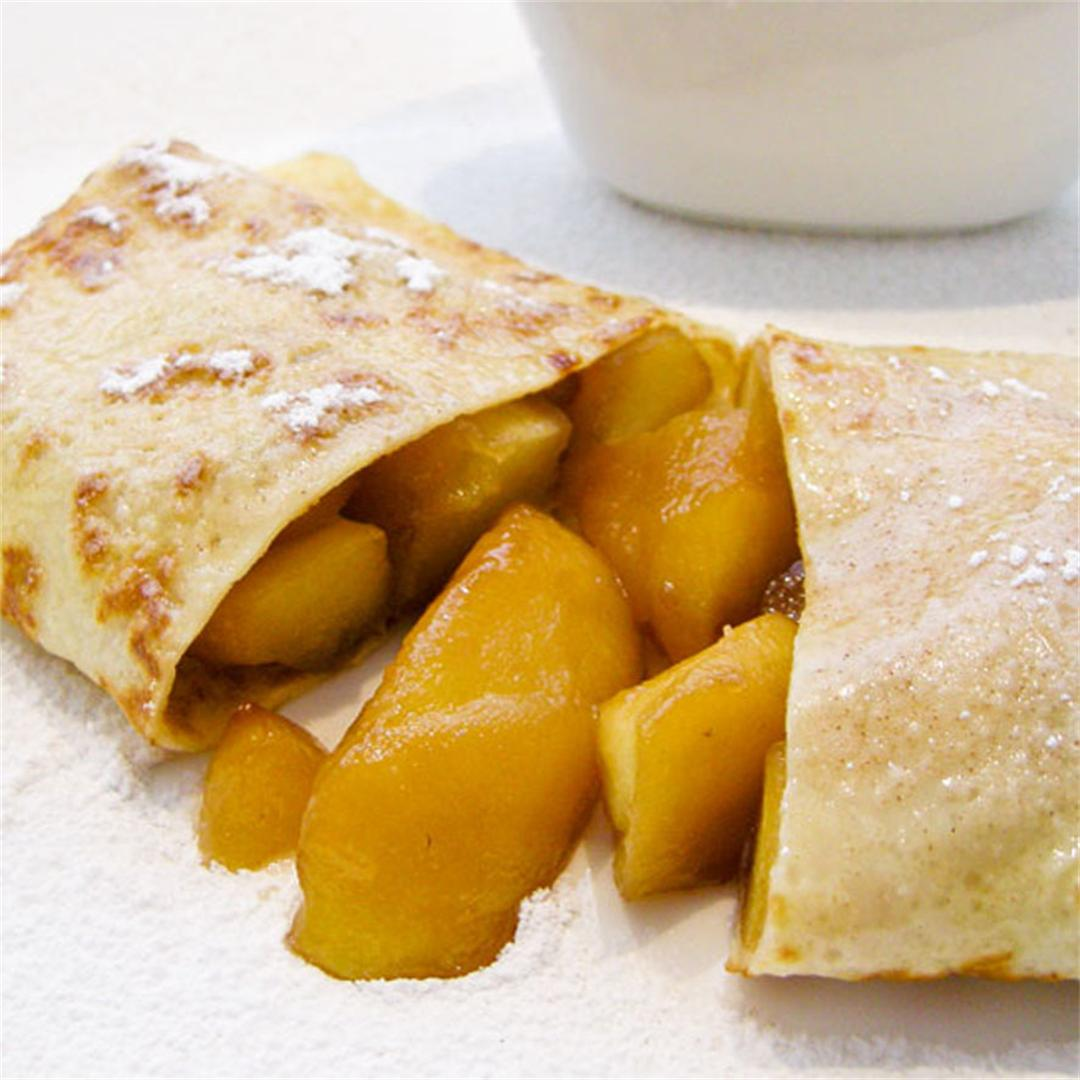 Delightful thin crepes filled with apples coated in caramel!