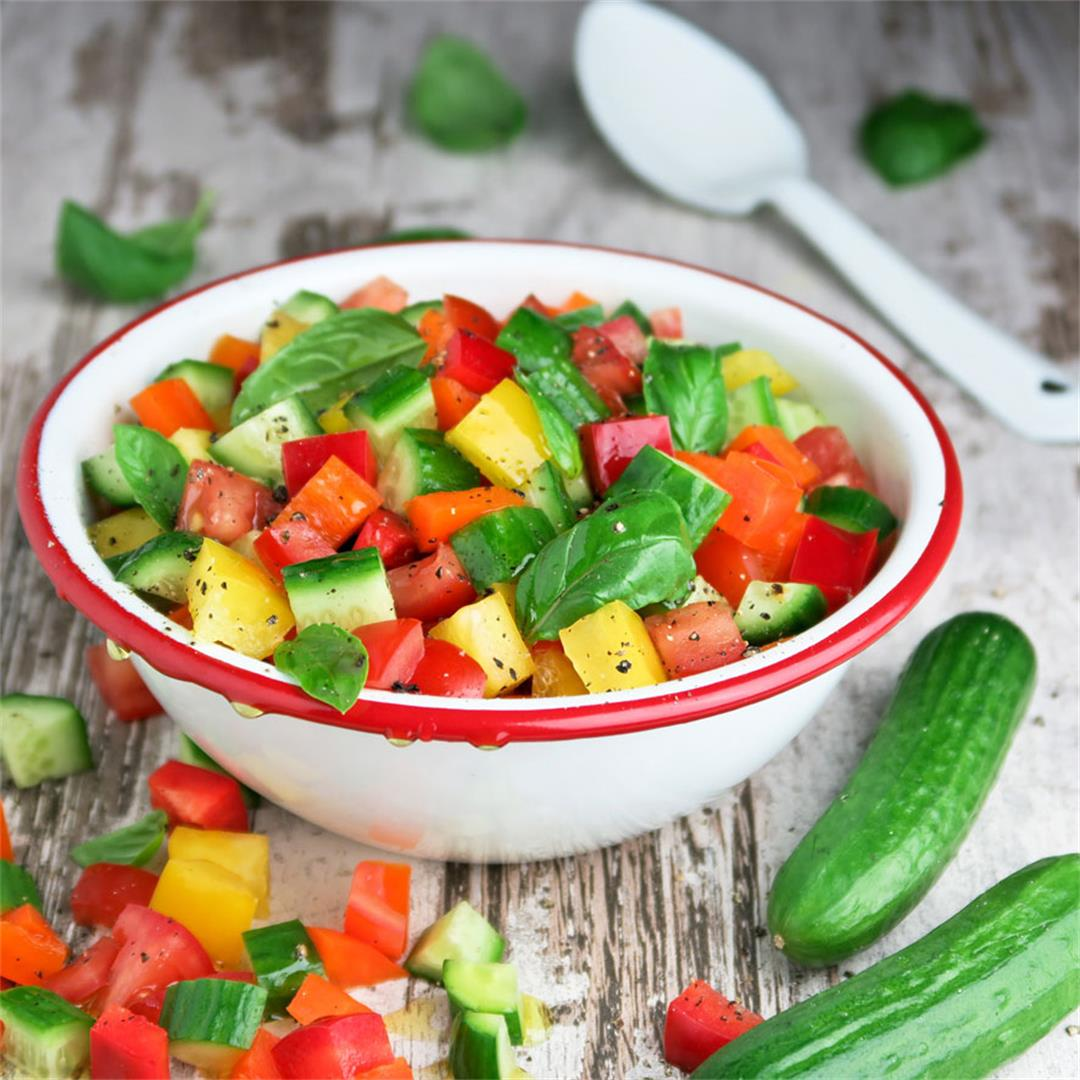 Delicious, fresh and healthy diced mixed salad with basil