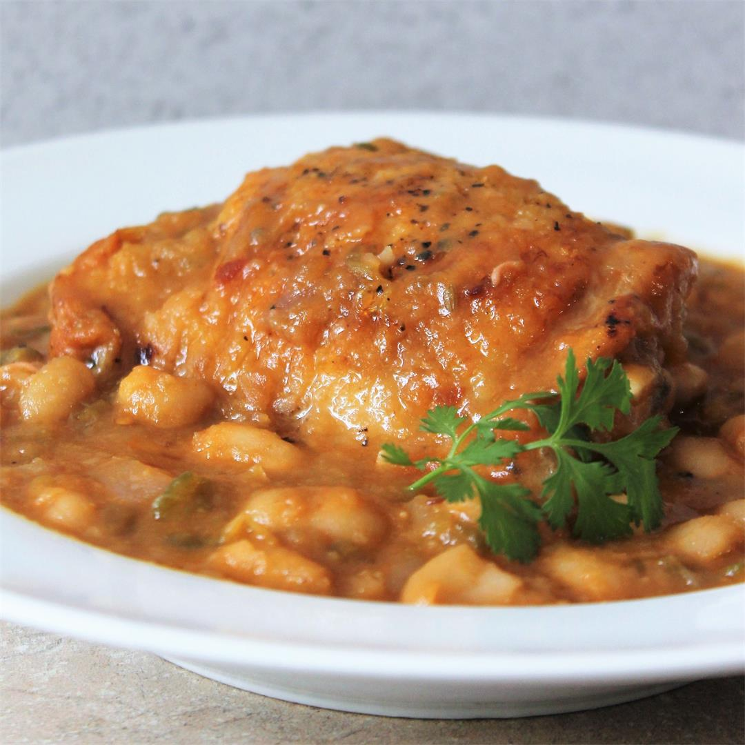Chicken Thighs seared and nestled into homemade BBQ Beans.