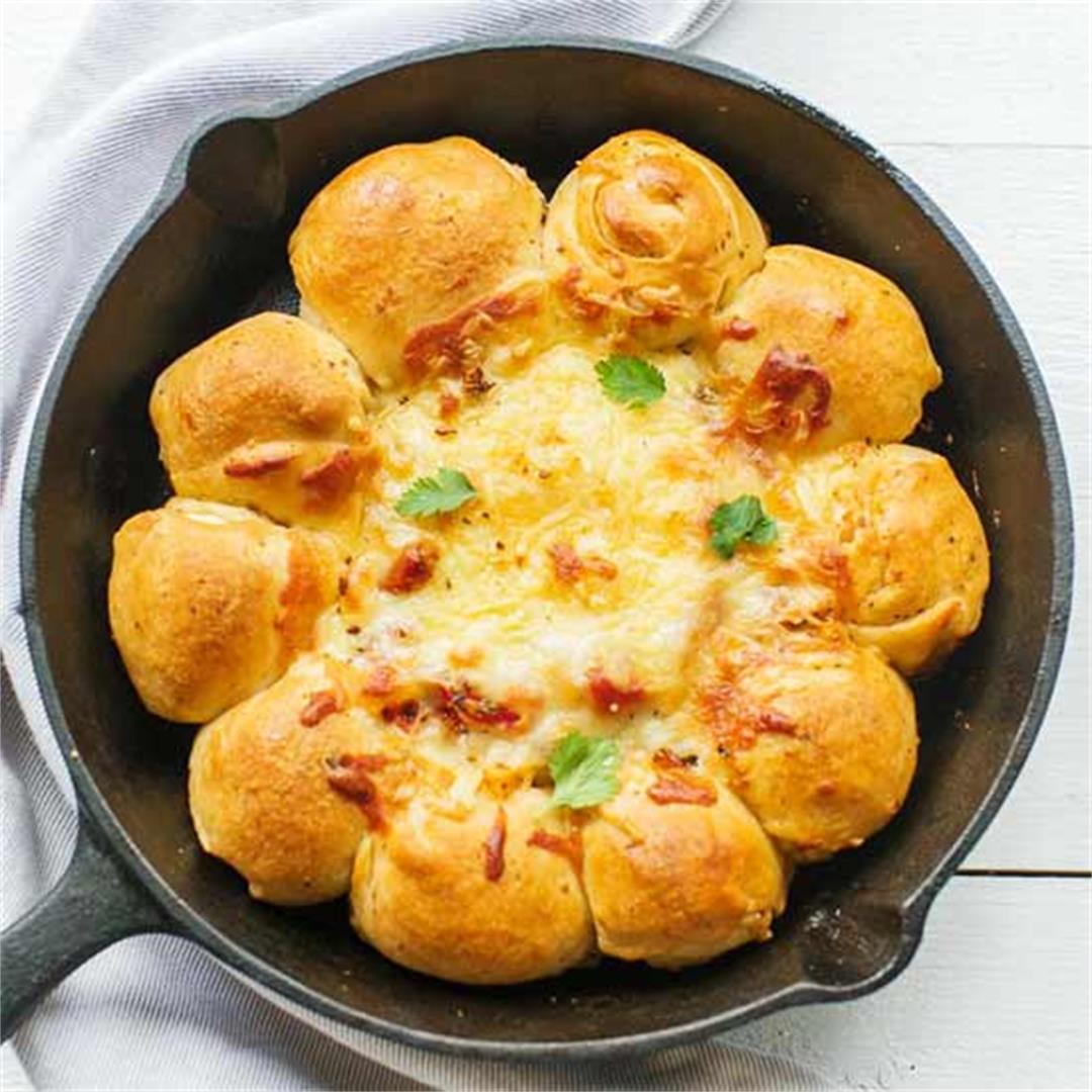 Pull apart pizza bread with tomato mozzarella cheese dip