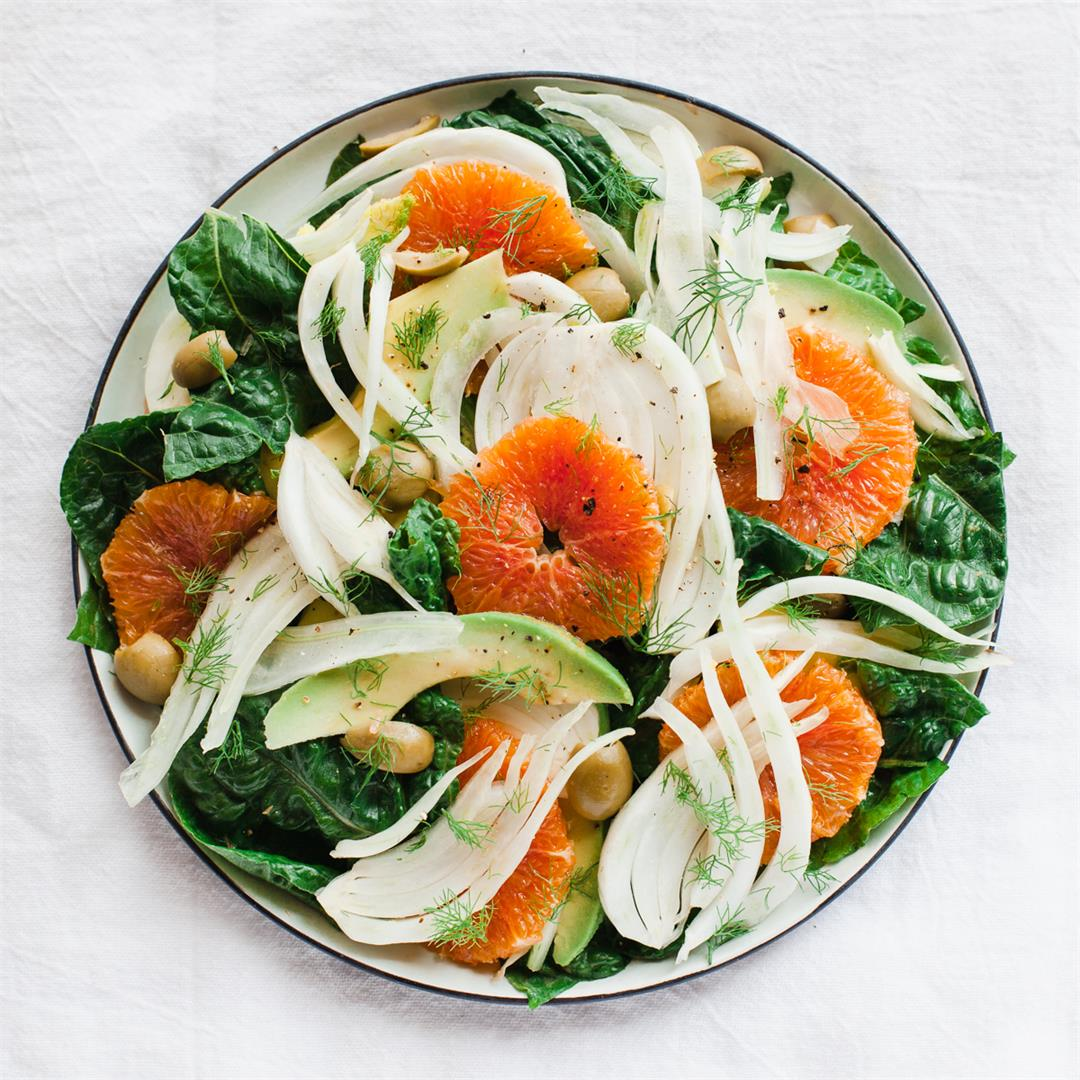 Orange, fennel and avocado salad topped with olives.
