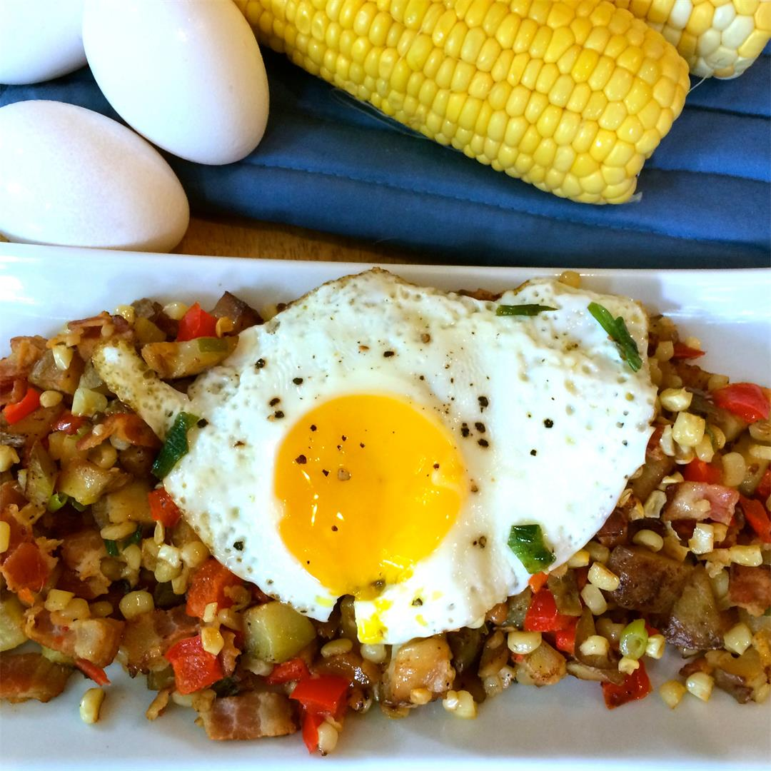 A hearty breakfast with summer corn, bacon, and crisp potatoes.