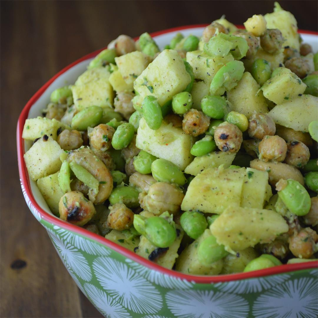 A healthy salad loaded with chickpeas, apples and cashews with