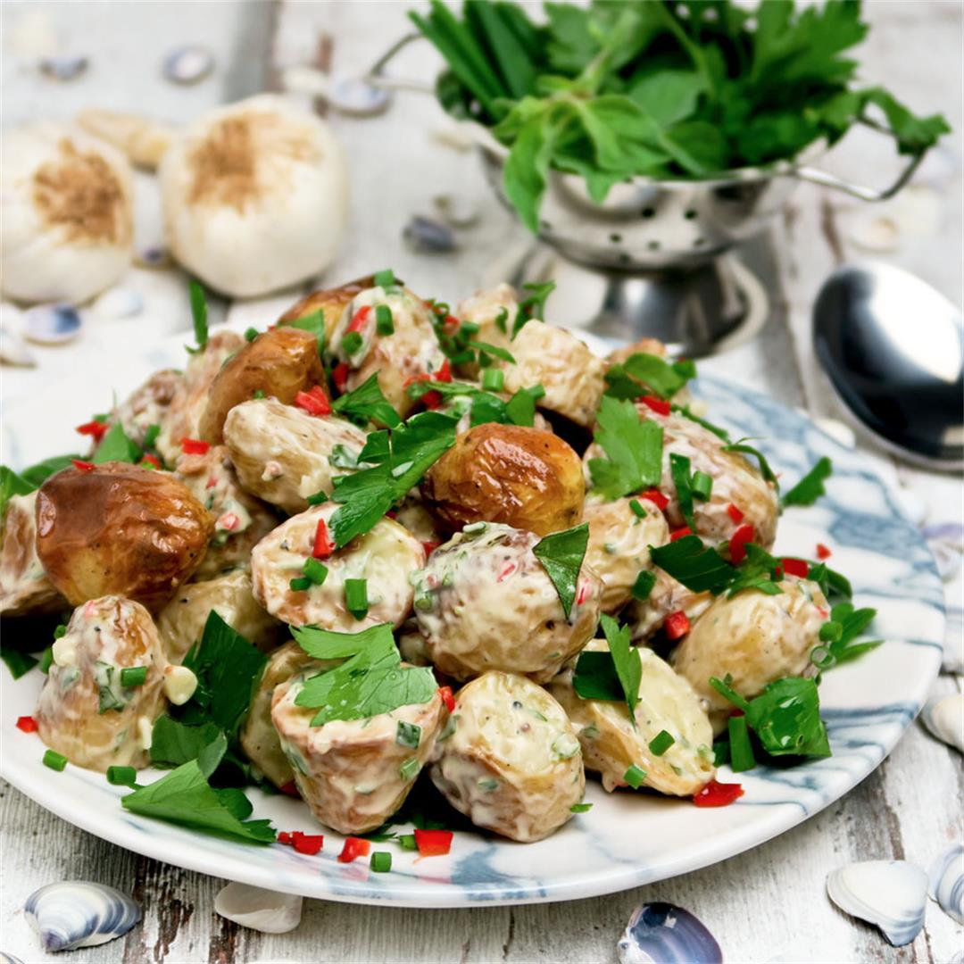 Salad of oven roasted baby potatoes, fresh herbs and garlic