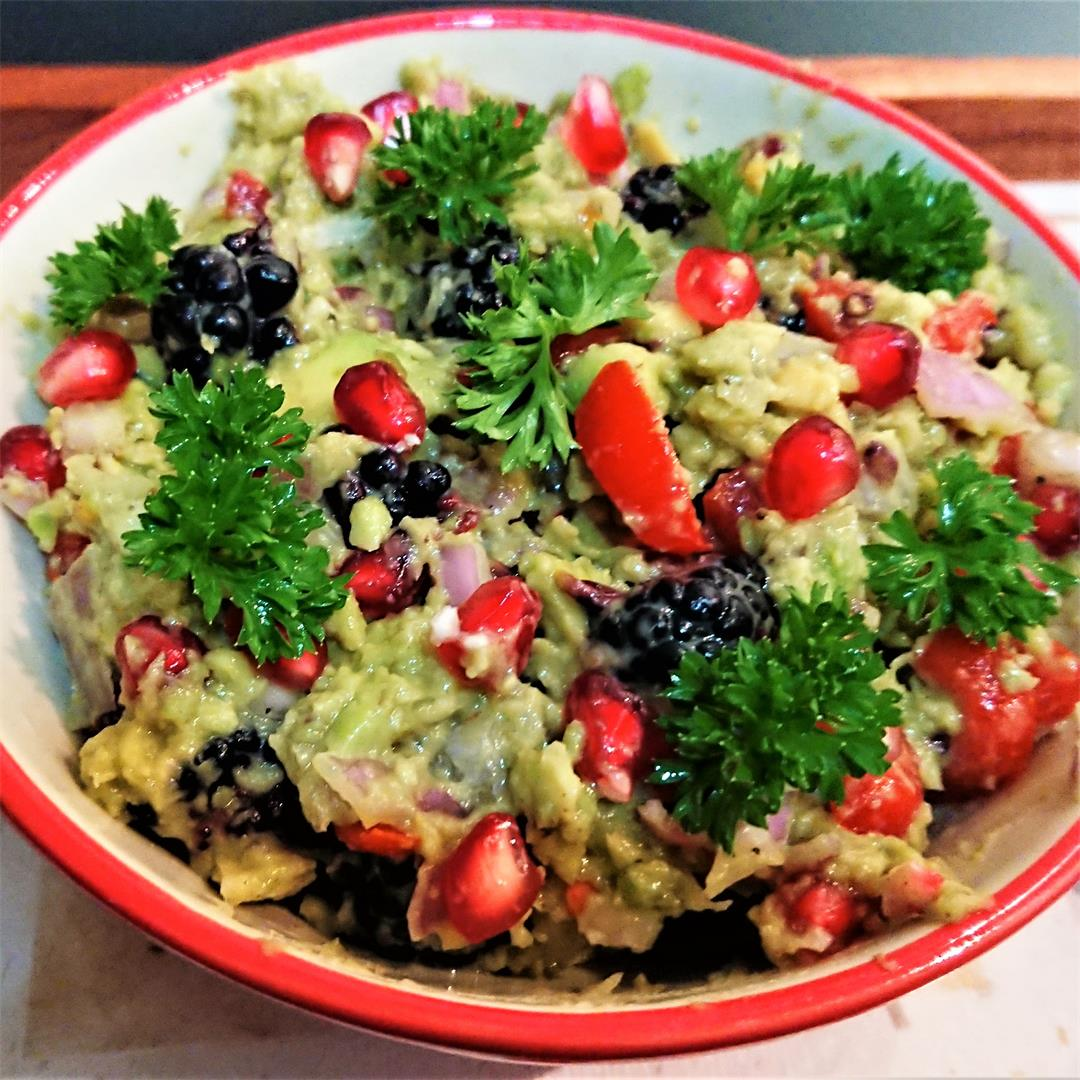 Guacamole with berries and pomegranate