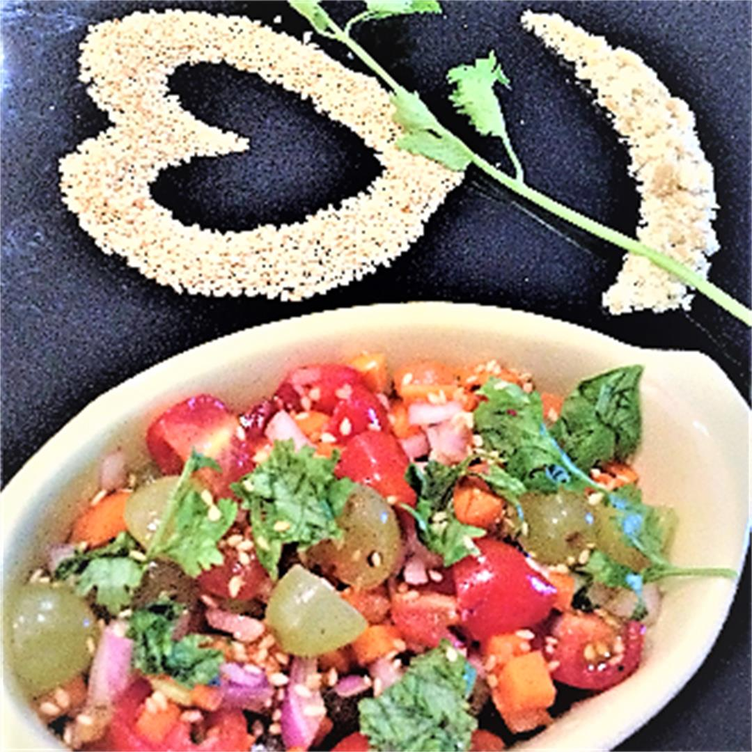 Cherry tomato and grape salad with sesame seeds