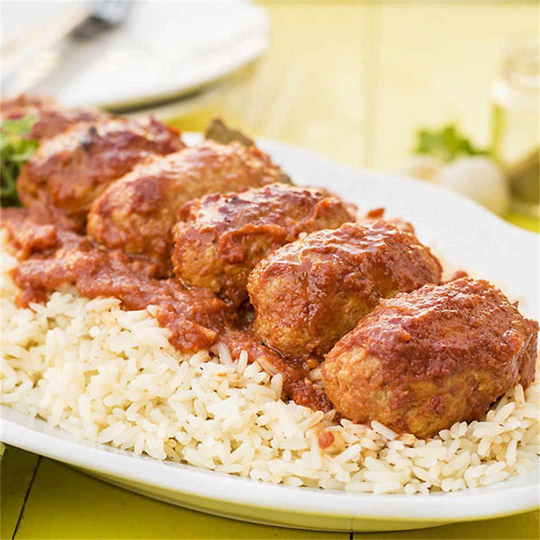 Greek baked meatballs in tomato sauce (soutzoukakia)