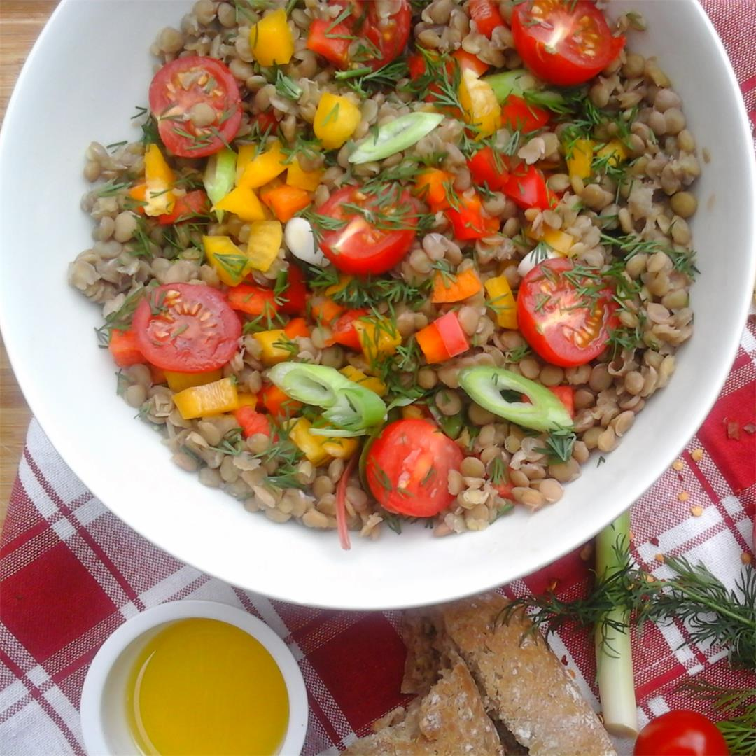 A healthy salad filled with Lentil, Tomatoes, Scallions