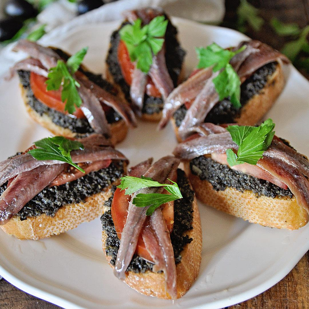Spanish Montaditos with Black Olive Tapenade and Anchovies