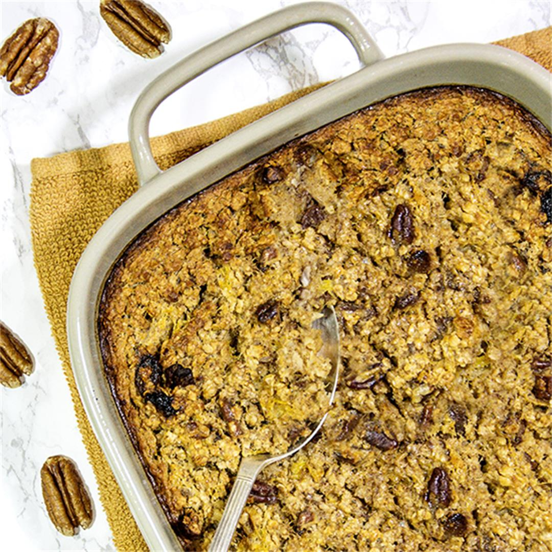 Pumpkin spiced baked oatmeal with maple syrup and raisins