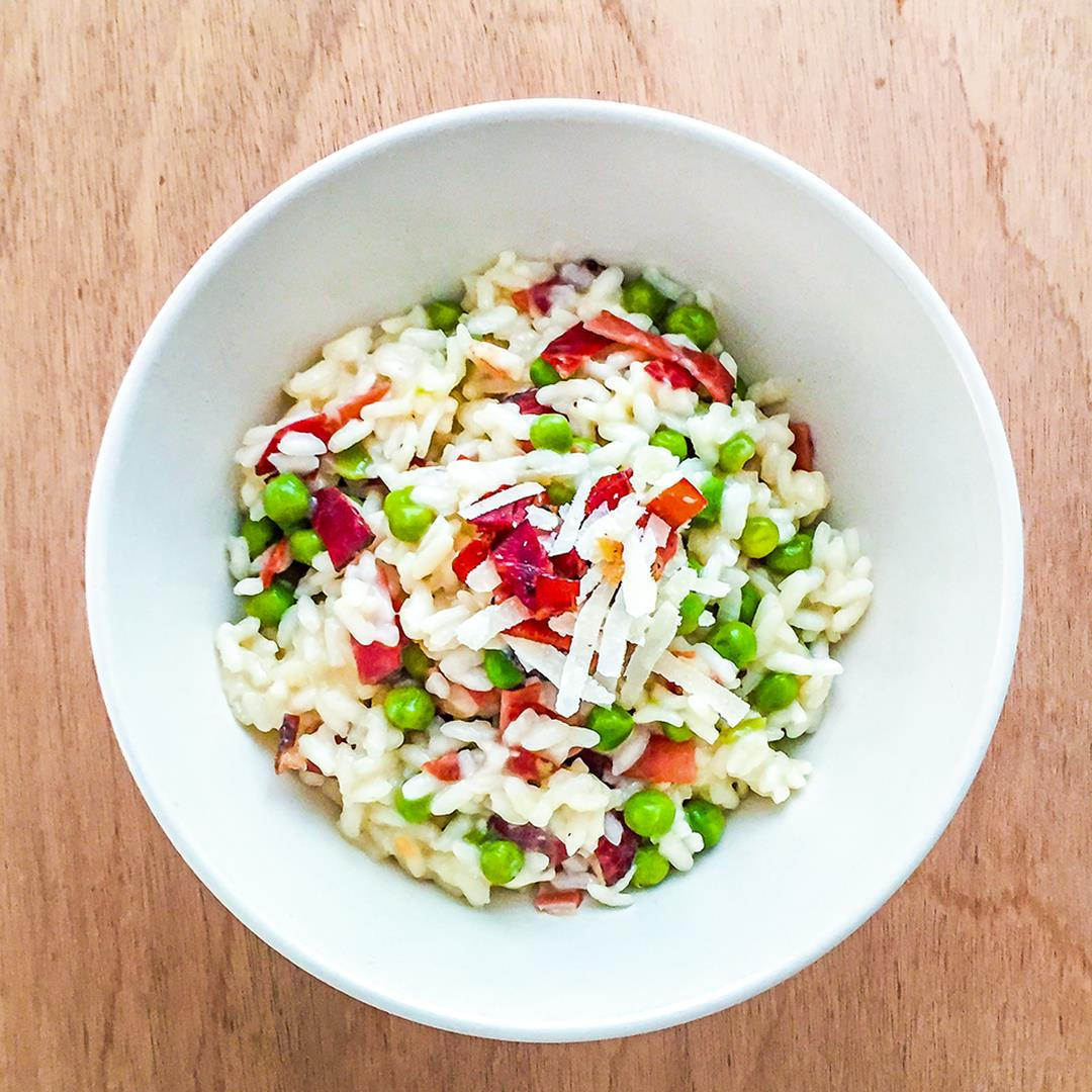 Creamy risotto with peas, smoked ham and parmesan cheese