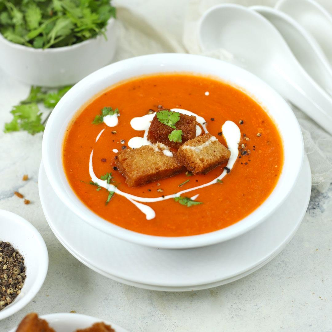 Tomato Soup – A classic creamy vegetarian soup served with brea