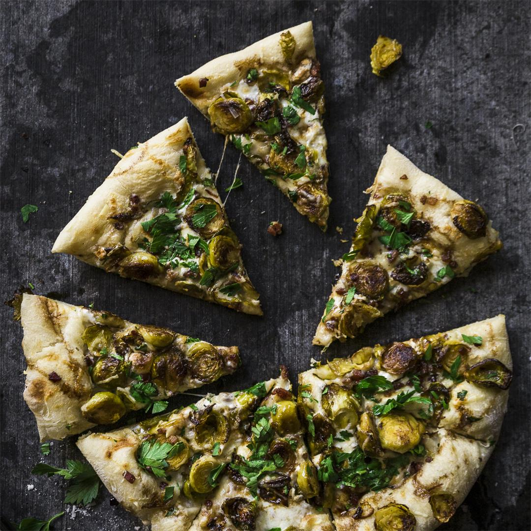 cast iron brussel sprout pizza with garlicky white sauce