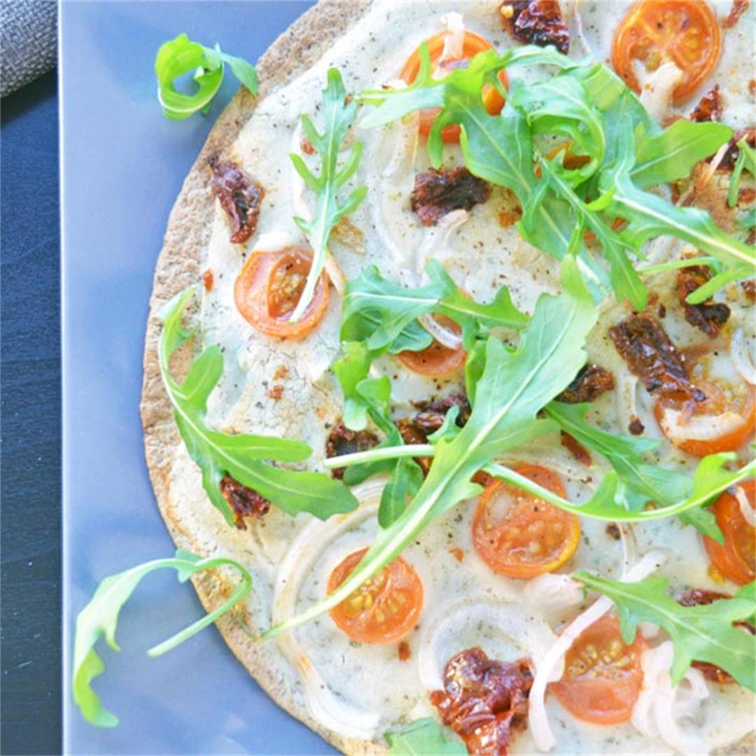 Tortilla Pizza with white bean purée, tomatoes & rocket (Vegan)