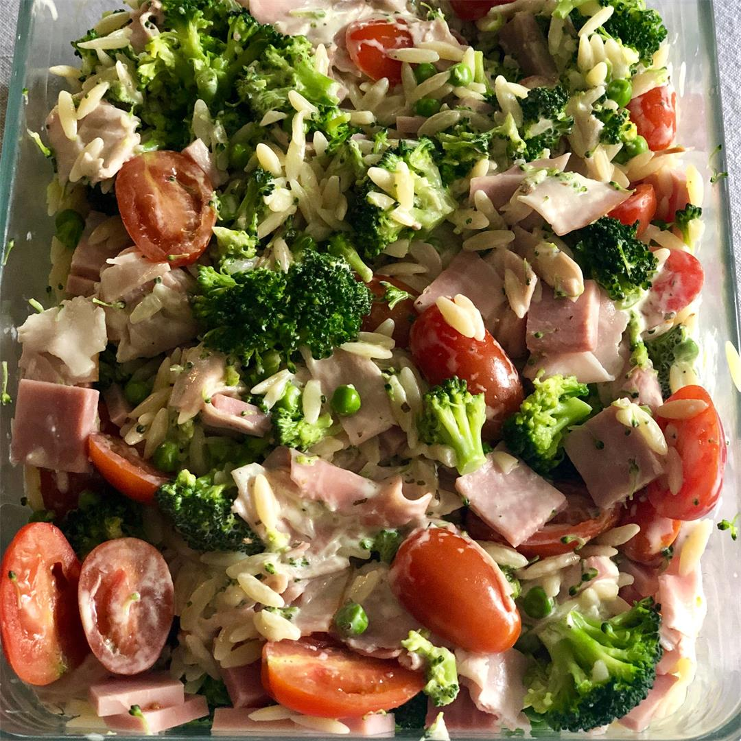 Healthy lukewarm green Greek pasta salad