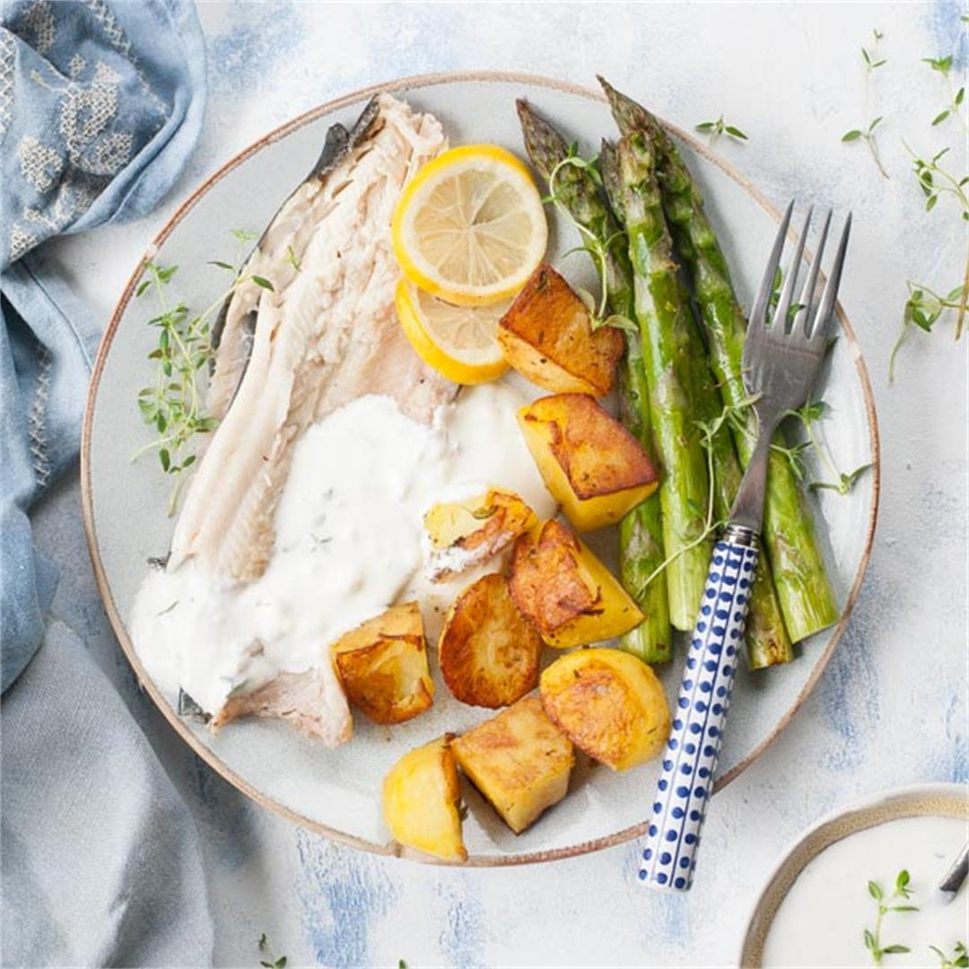 Whole roasted trout with potatoes and asparagus