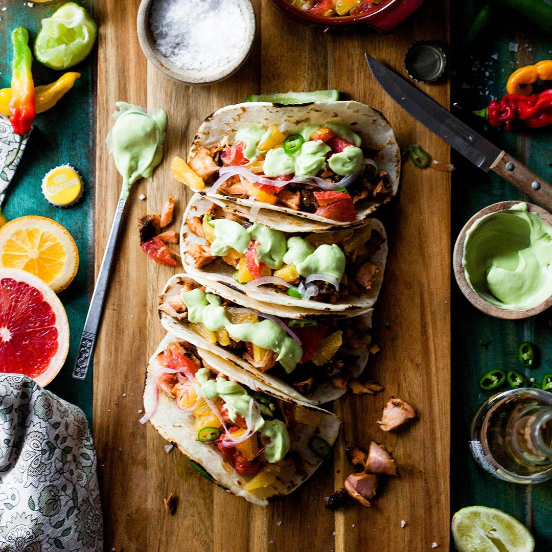 Firecracker Salmon Tacos with Citrus Salsa and Avocado Crema