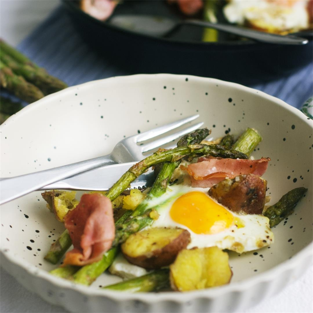 Baked Eggs With Potatoes Asparagus And Ham