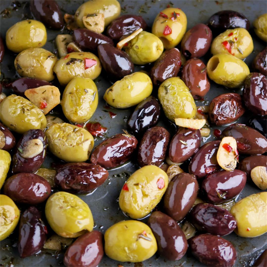 Warm and succulent oven roasted olives with garlic and herbs!