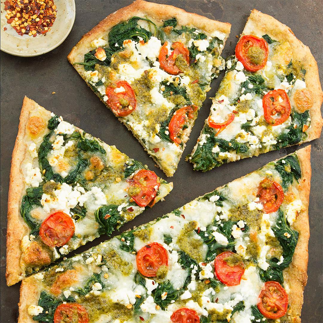 Spinach pizza with feta and pesto