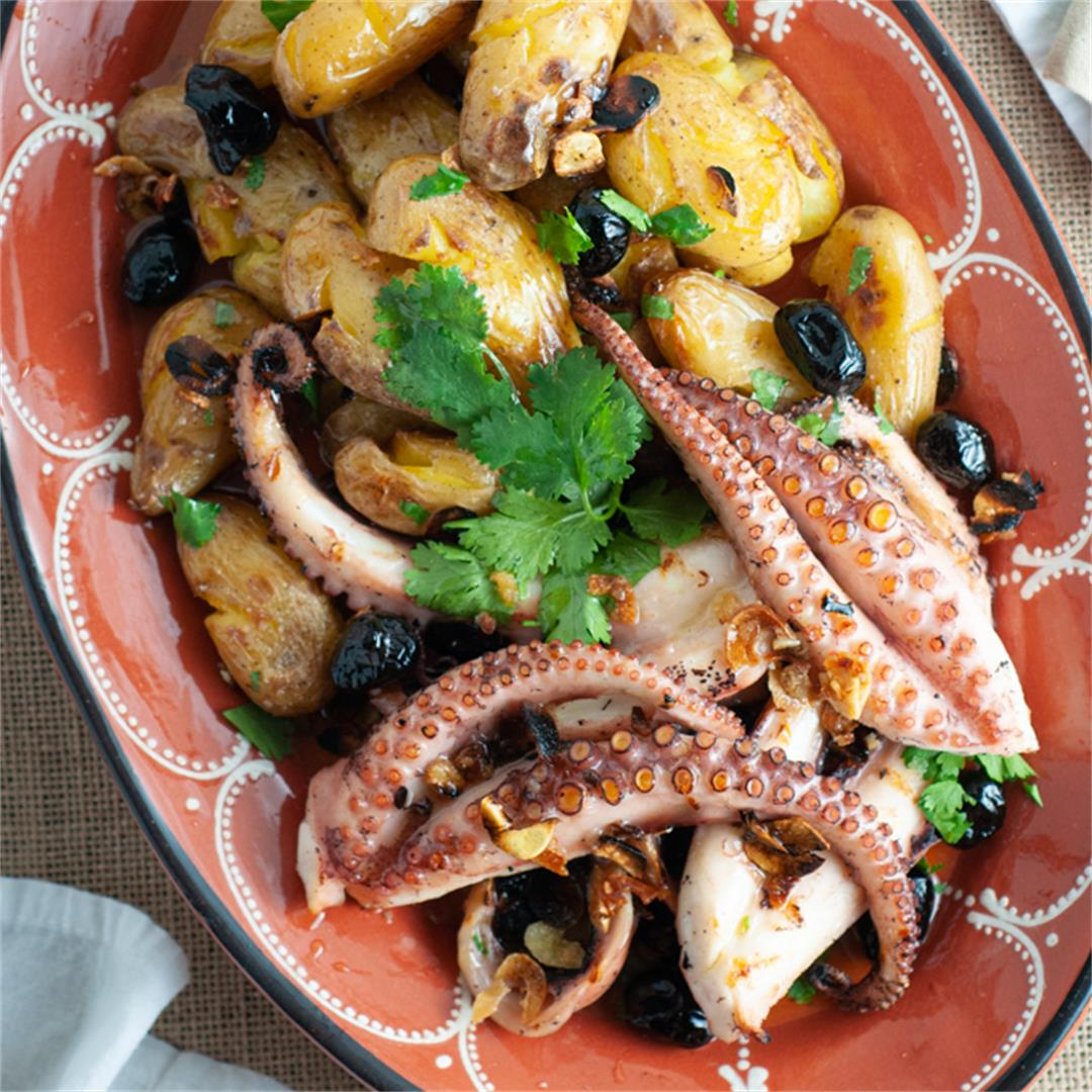 Portuguese style grilled octopus with smashed potatoes (polvo à