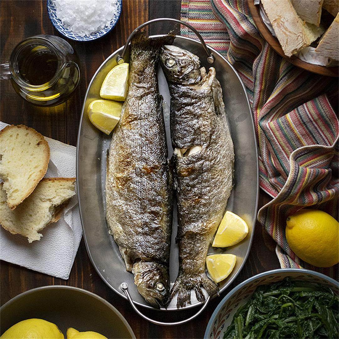 Simple broiled rainbow trout with dandelion greens