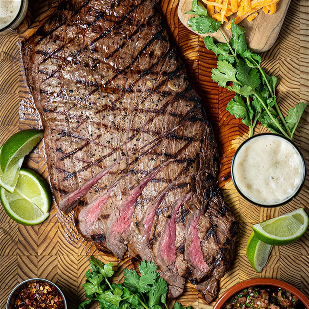 Marinated flank steak on the grill… juicy!
