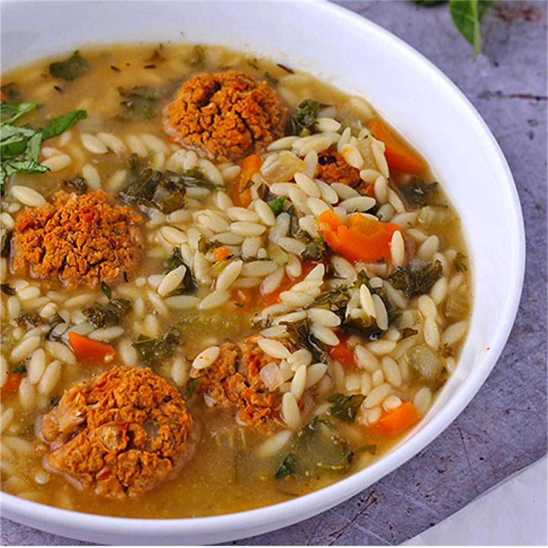 Kale vegetable soup with baked bean balls