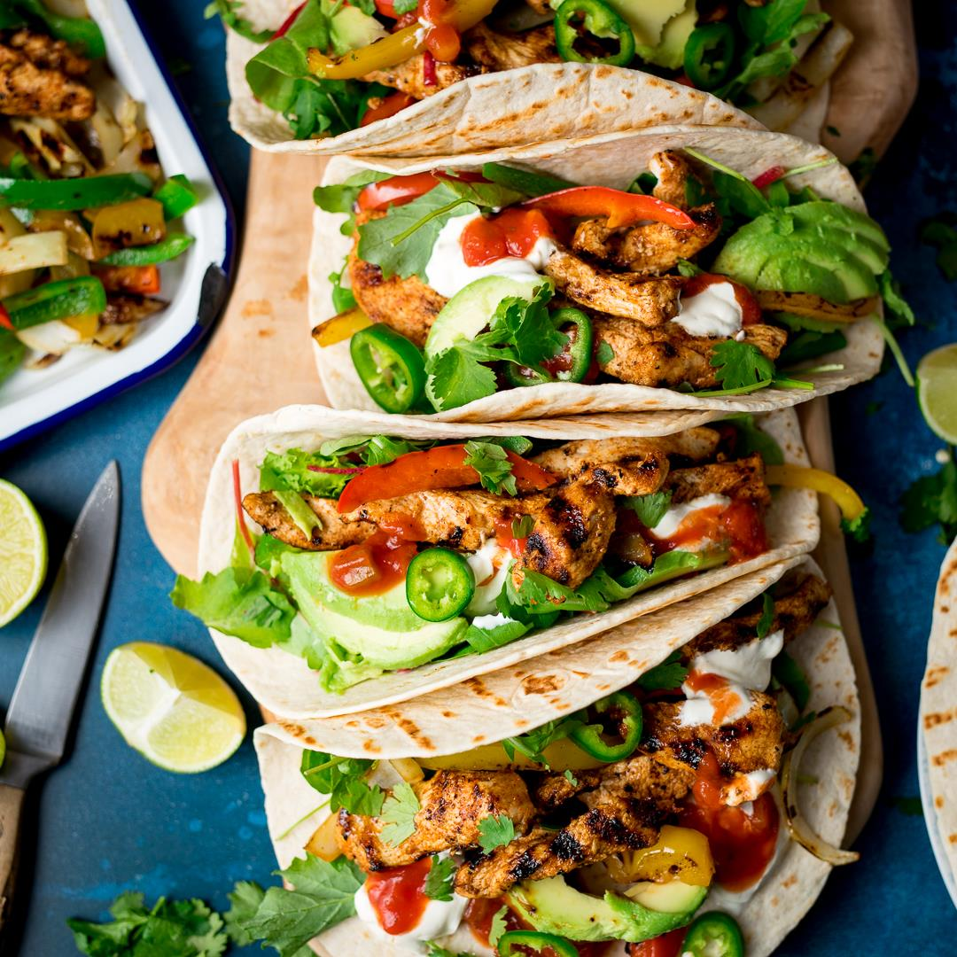 Easy Chicken Fajitas with ALL the toppings!