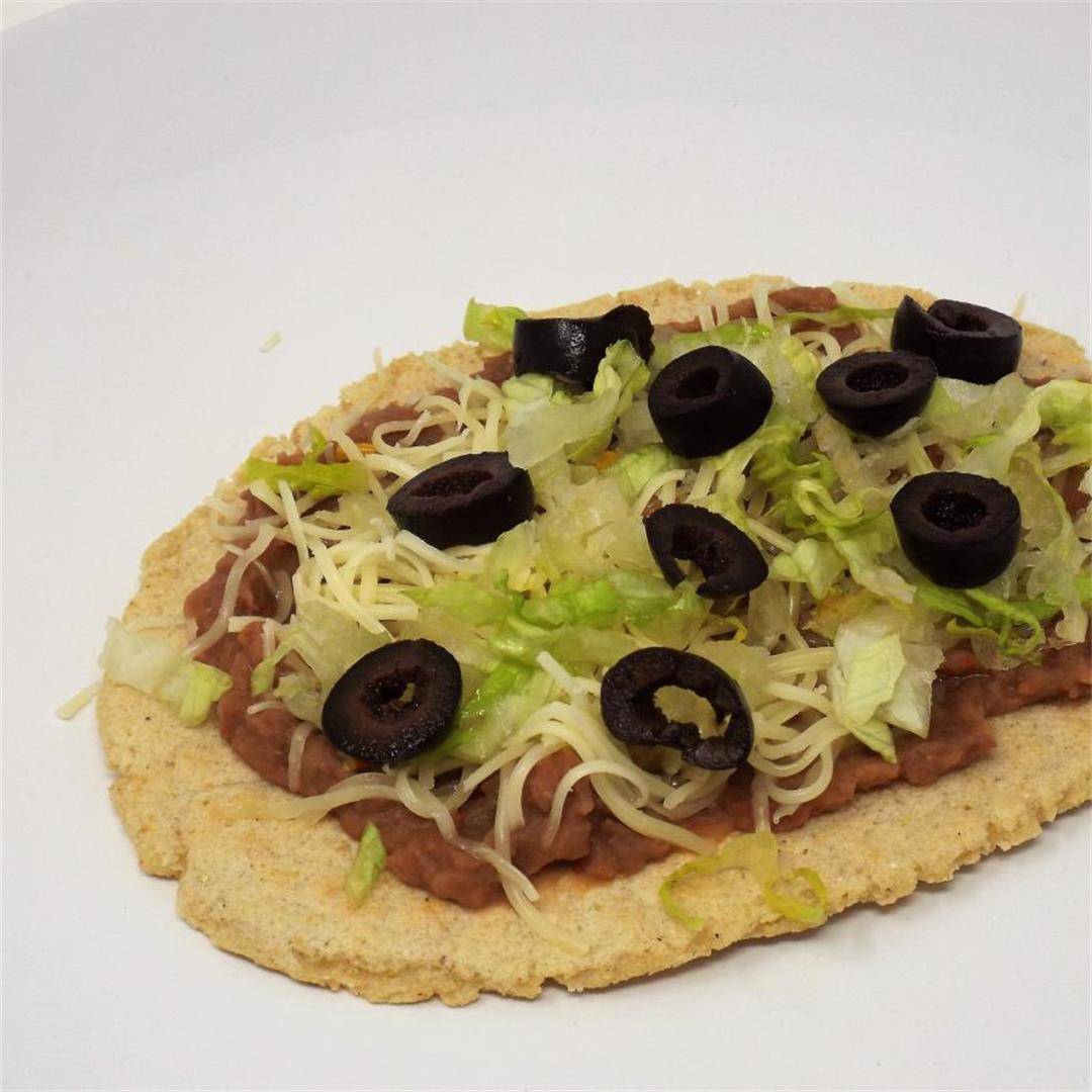Huaraches with Black Olives and Monterey Jack Cheese