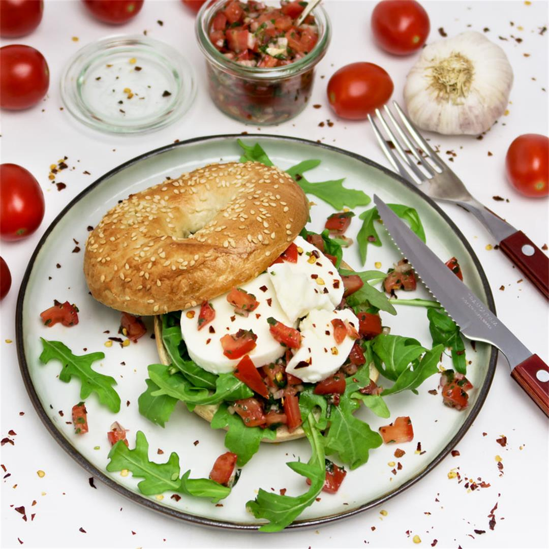 Caprese bagel with a spicy tomato, chili flakes and basil salsa
