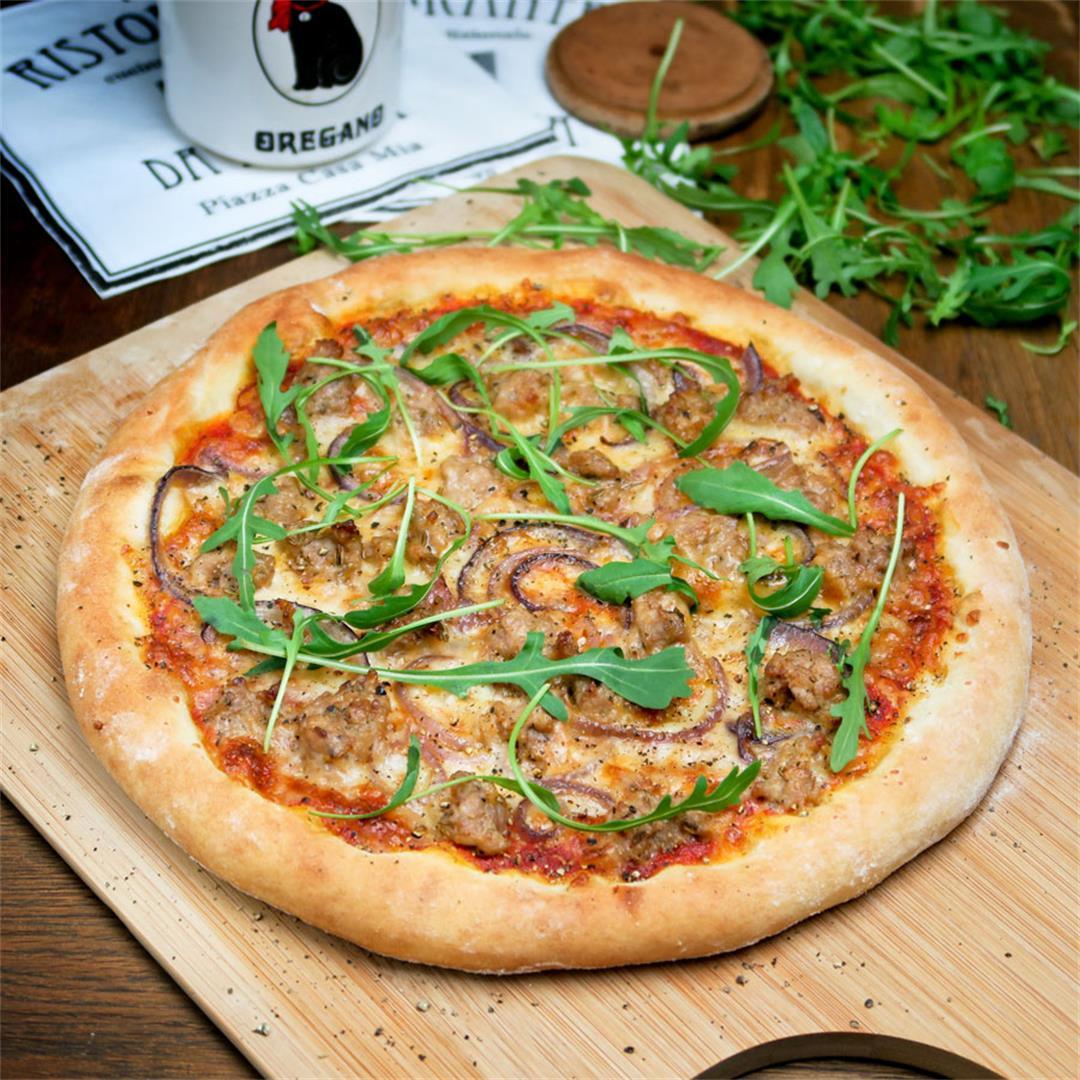 Divine Italian fennel sausage pizza with arugula