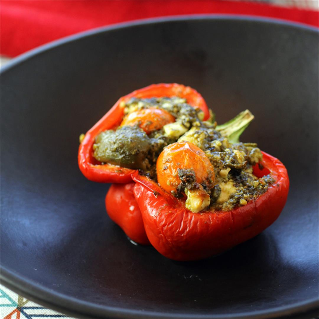 Peppers stuffed with feta, olives, pesto and cherry tomatoes