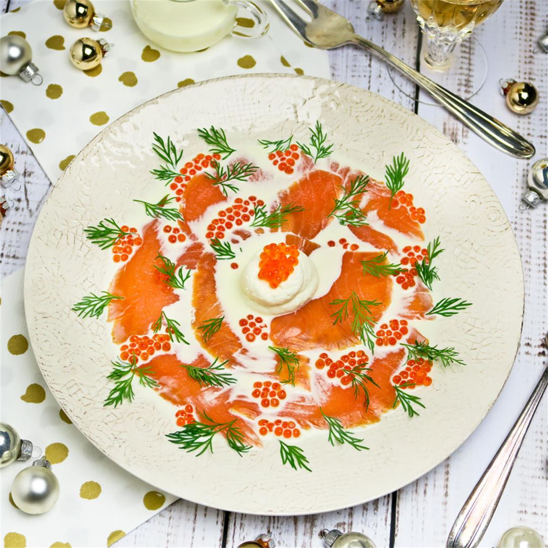 Smoked salmon carpaccio with trout caviar, cream and fresh dill